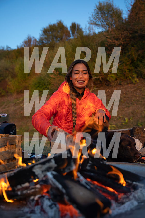 Woman at the campfire with winter jacket